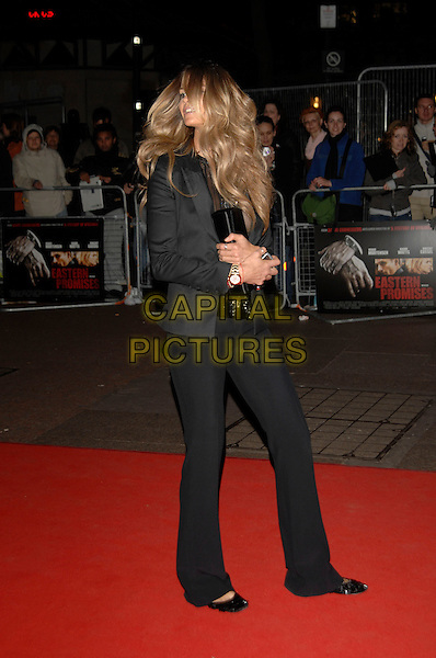 "ELLE MacPHERSON.""Eastern Promises"" film premiere, opening of London Film Festival. Odeon cinema, Leicester Square.17th October 2007 London, England.full length black jacket trousers sheer top see through thru clutch purse bag pumps .Ref: CAP/PL.©Phil Loftus/Capital Pictures"