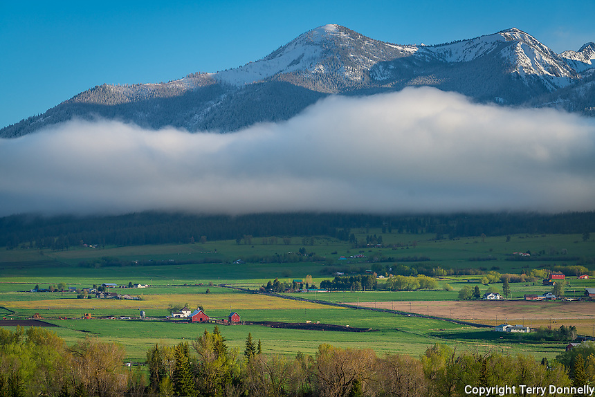 Wallowa County, Oregon:<br /> Spring snow dusts the Wallowa mountains above the Wallowa valley near  Enterprise