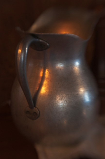 Close up of a silver water pitcher in a Texas restaurant.