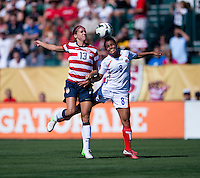 Alex Morgan (13) of the USWNT collides with Daniela Cruz (8) of Costa Rica during a friendly match at Sahlen's Stadium in Rochester, NY.  The USWNT defeated Costa Rica, 8-0.