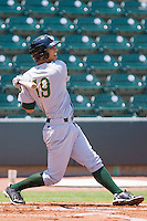 Neftali Soto #19 of the Lynchburg Hillcats follows through on his swing against the Winston-Salem Dash at  BB&T Ballpark July 11, 2010, in Winston-Salem, North Carolina.  Photo by Brian Westerholt / Four Seam Images