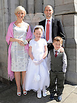Sadhbh Price from Scoil Aonghusa who recieved first holy communion at St Peters church West street pictured with parents Peter and Barbara and brother Paddy. Photo: Colin Bell/pressphotos.ie