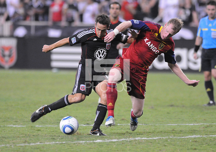 D.C. United forward Josh Wolff (16) goes against Real Salt Lake midfielder Will Johnson (8). D.C. United defeated Real Salt Lake 4-0 at RFK Stadium, Saturday September 24 , 2011.