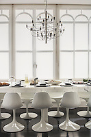 The carrara marble table in the kitchen was designed by Ronnie Sassoon and is lined with Eero Saarinen tulip chairs