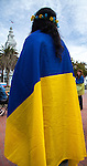 People wrapped themselves in the Ukrainian flag at the Ukrainian rally at Justin Herman Plaza in San Francisco, California on Sunday, March 9th, 2014.  Photo/Victoria Sheridan