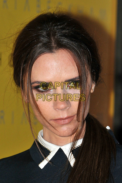 Victoria Beckham .launches her new fashion line 'Victoria by Victora Beckham' during London Fashion Week, Harvey Nichols, Knightsbridge, London, England, UK, February 17th 2012..portrait headshot beauty hair ponytail make-up close-up  eyeliner .CAP/BF.©Bob Fidgeon/Capital Pictures.