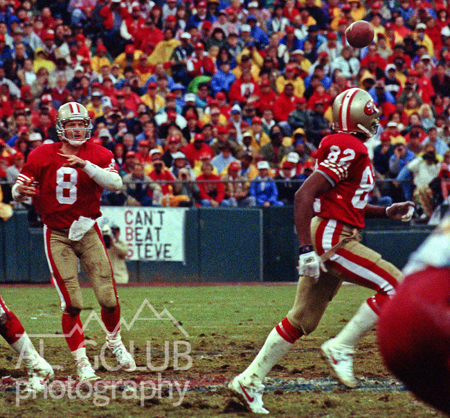 San Francisco 49ers vs. Washington Redskins at Candlestick Park Saturday, January 9,1993.  49ers Beat Redskins 20-13.  San Francisco 49ers quarterback Steve Young (8) passes to wide receiver John Taylor (82).