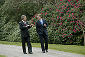 President George W. Bush and British Prime Minister Tony Blair walk through the grounds of Hillsborough Castle in Northern Ireland, Monday, April 7, 2003.<br /> Mandatory Credit: Eric Draper / White House via CNP