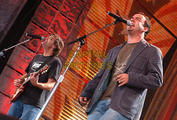 DAVE MATTHEWS performs with WIDESPREAD PANIC (vocalist - JOHN BELL).20th Anniversary FARM AID 2005 held at the Tweeter Center, Tinley Park, IL, USA..September 18th, 2005.Photo by Jason Nelson/AdMedia/Capital Pictures.Ref: JN/CAP.half length stage concert gig performance singing.www.capitalpictures.com.sales@capitalpictures.com.© Capital Pictures.