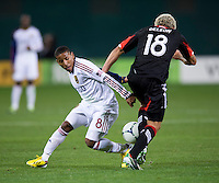 Nick DeLeon (18) of D.C. United strips the ball away from Joao Plata (8) of Real Salt Lake during the game at RFK Stadium in Washington, DC.  D.C. United defeated Real Salt Lake, 1-0.