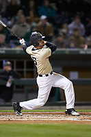 Jake Mueller (6) of the Wake Forest Demon Deacons follows through on his swing against the Charlotte 49ers at BB&T BallPark on March 13, 2018 in Charlotte, North Carolina.  The 49ers defeated the Demon Deacons 13-1.  (Brian Westerholt/Four Seam Images)