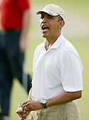 United States President Barack Obama speaks to the crowd after missing his putt on the 18th hole at the 18th hole at the Mid Pacific Country Club in Lanikai, Hawaii on January 1, 2014.<br /> Credit: Cory Lum / Pool via CNP