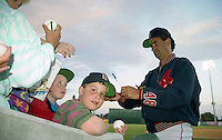 Boston Red Sox pitcher Tony Fossas (48) signs autographs during spring training circa 1993 at Chain of Lakes Park in Winter Haven, Florida.  (MJA/Four Seam Images)