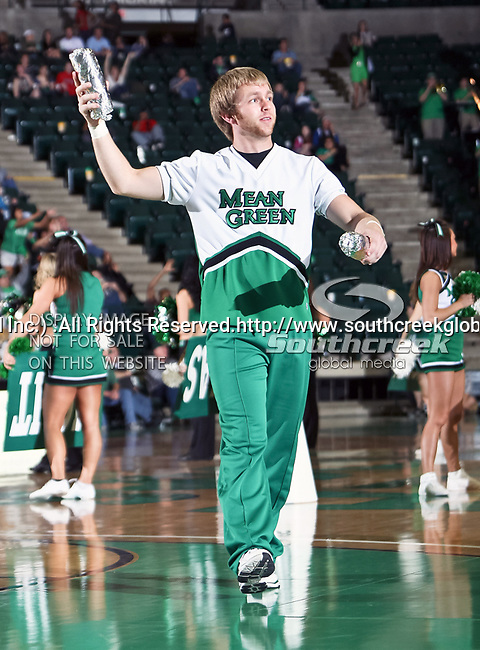A North Texas Mean Green cheerleader prepares to toss out some free T-shirts during the NCAA  basketball game between the South Alabama Jaguars and the University of North Texas Mean Green at the North Texas Coliseum,the Super Pit, in Denton, Texas. UNT defeated South Alabama 82 to 79...