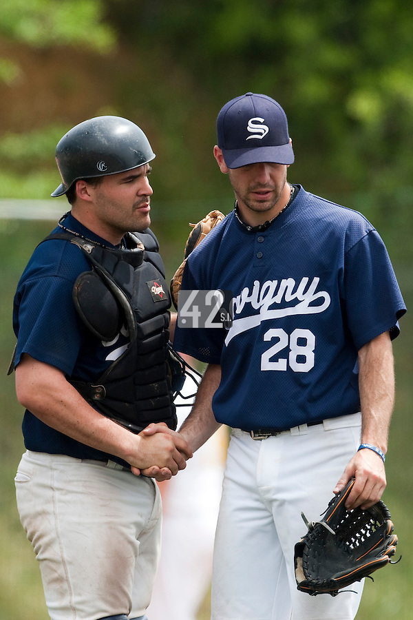 23 May 2009: Pierrick Lemestre of Savigny is congratulated by Vincent Ferreira as he pitches against Senart during the 2009 challenge de France, a tournament with the best French baseball teams - all eight elite league clubs - to determine a spot in the European Cup next year, at Montpellier, France. Savigny wins 4-1 over Senart.