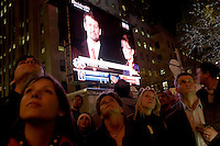 New York, NY - 4 November 2008 Crowds gathered in Rockefeller Center, dubbed Election Plaza, to watch the 2008 election results, broadcast live, and displayed on huge flat panel tv screens. Republican Vice Presidential Candidate and Alaska Governor Sarah Palin and her husband appear on the screen.