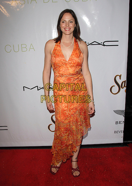 "JORJA FOX.The ""What A Pair!"" Concert benefitting The John Wayne Cancer Institute. The Fundraiser was held at The Wiltern Theatre in Los Angeles , California, USA..June 11th, 2006.Ref: DVS.full length orange dress .www.capitalpictures.com.sales@capitalpictures.com.Supplied By Capital PIctures"