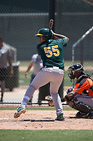 Oakland Athletics catcher Santis Sanchez (55) at bat during an Extended Spring Training game against the San Francisco Giants Orange at the Lew Wolff Training Complex on May 29, 2018 in Mesa, Arizona. (Zachary Lucy/Four Seam Images)
