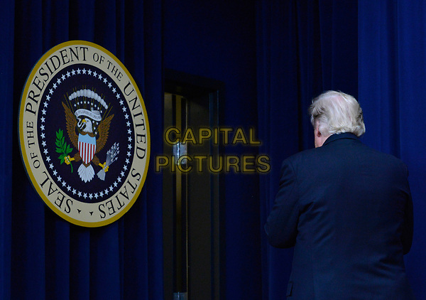 United States President Donald Trump leaves after speaking during a CEO town hall on the American business climate in the South Court Auditorium of the White House in Washington, DC, April 4, 2017.<br /> CAP/MPI/CNP/RS<br /> &copy;RS/CNP/MPI/Capital Pictures