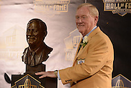 Canton, Ohio - August 8, 2015: Bill Polian, former NFL team executive, poses with his bust during the 2015 Pro Football Hall of Fame enshrinement dinner in Canton, Ohio, August 8, 2015. During his 32-season career, Polian made contributions to three different NFL teams that resulted in a combined five Super Bowls.(Photo by Don Baxter/Media Images International)