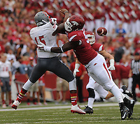 NWA Media/ANDY SHUPE - Arkansas defensive end Anthony Brown hurries Nicholls quarterback Kalen Henderson during the second quarter Saturday, Sept. 6, 2014, at Razorback Stadium in Fayetteville