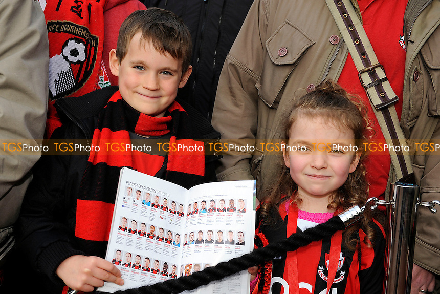 Two young AFC Bournemouth fans - AFC Bournemouth vs Liverpool - FA Cup 4th Round Football at the Goldsands Stadium, Bournemouth, Dorset - 25/01/14 - MANDATORY CREDIT: Denis Murphy/TGSPHOTO - Self billing applies where appropriate - 0845 094 6026 - contact@tgsphoto.co.uk - NO UNPAID USE