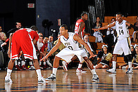 28 January 2012:  FIU guard Cameron Bell (10) defends WKU guard Jamal Crook (14) in the second half as the Western Kentucky University Hilltoppers defeated the FIU Golden Panthers, 61-51, at the U.S. Century Bank Arena in Miami, Florida.