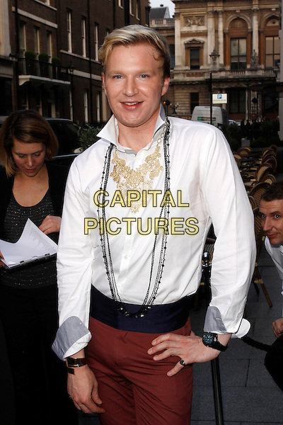 Henry Conway.The London-boutiques.com launch party, The Embassy Club, London, England..May 23rd, 2012.half length white shirt yellow armpit sweat patch hand on hip.CAP/AH.©Adam Houghton/Capital Pictures.