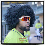 Walter Rasquin (22) of the Columbia Fireflies has some fun with a fluffy wig as the season winds down before a game against the Hickory Crawdads on Wednesday, August 28, 2019, at Segra Park in Columbia, South Carolina. Hickory won, 7-0. (Tom Priddy/Four Seam Images) #MiLB