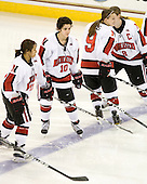 Rachel Llanes (NU - 11), Autumn Prouty (NU - 10), Casie Fields (NU - 9) - The Harvard University Crimson defeated the Northeastern University Huskies 4-3 (SO) in the opening round of the Beanpot on Tuesday, February 8, 2011, at Conte Forum in Chestnut Hill, Massachusetts.