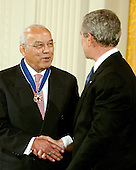 "Washington, D.C. - December 15, 2006 -- Norman C. Francis receives the Presidential Medal of Freedom  from United States President George W. Bush and first lady Laura Bush during a ceremony in the East Room of the White House on Friday, December 15, 2006.  The medal is the nation's highest civil award.  It may be awarded ""to any person who has made an especially meritorious contribution to (1) the security or national interests of the United States, or, (2) world peace, or (3) cultural or other significant public or private endeavors"".  During his nearly 40 years as President of Xavier University of Louisiana, Dr. Norman Francis has demonstrated a steadfast dedication to education, equality, and service to others.  Throughout his career, he has led religious, educational, and civil rights organizations and has made significant contributions to the important work of Historically Black Colleges and Universities.  As Chairman of the Louisiana Recovery Authority, he has played a vital role in helping the people of the Gulf Coast rebuild their lives in the aftermath of Hurricane Katrina.  The United States honors Norman C. Francis for his leadership, compassion, and commitment to education.<br /> Credit: Ron Sachs / CNP"