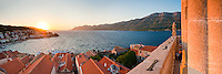 St Marks Cathedral bell tower and Korcula Town, panoramic photo at sunset, Croatia. This is a panoramic photo of Korcula Town, the main town on Korcula Island at sunset. On the right of the picture is St Marks Cathedral bell tower, from which this panoramic photo was taken. St Marks Cathedral bell tower provides beautiful panoramic views over the whole of Korcula Town and the Dalmatian Coast, especially at sunset.