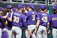 LSU Tigers starting pitcher Cole Henry (18) is congratulated by his teammates as he is removed from the game against the Georgia Bulldogs at Foley Field on March 23, 2019 in Athens, Georgia. The Bulldogs defeated the Tigers 2-0. (Brian Westerholt/Four Seam Images)