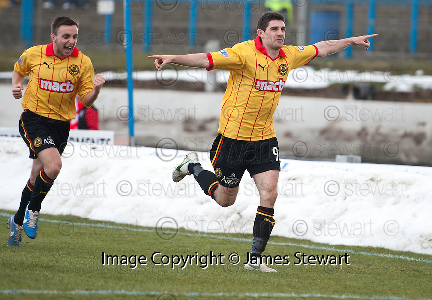 Thistle's Kris Doolan celebrates after he scores their second goal.