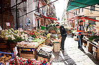 Giuseppe Fiorentino, who has been working at Il Capo Markets since he was a child, busily prepares his fresh produce for a day of trading,  Palermo, Sicily.