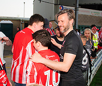 Lincoln City's assistant manager Nicky Cowley poses with fans at the end of the game<br /> <br /> Photographer Andrew Vaughan/CameraSport<br /> <br /> The EFL Sky Bet League Two - Lincoln City v Tranmere Rovers - Monday 22nd April 2019 - Sincil Bank - Lincoln<br /> <br /> World Copyright © 2019 CameraSport. All rights reserved. 43 Linden Ave. Countesthorpe. Leicester. England. LE8 5PG - Tel: +44 (0) 116 277 4147 - admin@camerasport.com - www.camerasport.com