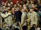 U.S. Service members gather around President George W. Bush to shake his hand during a visit to Al Asad Air Base, Iraq, Sept. 3, 2007.  Bush was joined by Secretary of Defense Robert M. Gates, Secretary of State Condolezza Rice, Chairman of the Joint Chiefs of Staff Gen. Peter Pace, U.S. Central Command Commander Adm. William J. Fallon, Commander of Multinational Forces-Iraq Gen. David Petreaus, Commander of Multinational Corps-Iraq Lt. Gen. Ray Odierno, and others.  Defense Dept. photo by Cherie A. Thurlby (released)