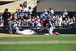 5 March 2009: Washington Nationals' first baseman Nick Johnson attempts a pickoff tag on Adam Everett during a Spring Training game against the Detroit Tigers at Joker Marchant Stadium in Lakeland, Florida. The Tigers defeated the visiting Nationals 10-2 in the Grapefruit League matchup. Mandatory Photo Credit: Ed Wolfstein Photo