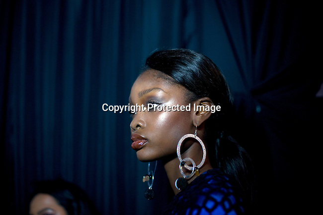 JOHANNESBURG, SOUTH AFRICA OCTOBER 31: Sixteen year old Nigerian model walking for the designer label Kiki Romeo from Kenya has her makeup done backstage before a show at Mercedes Benz Africa fashion week Africa on October 31, 2014 held at Melrose Arch in Johannesburg, South Africa. Designers from all over Africa showed their best collections at the yearly event. (Photo by: Per-Anders Pettersson)
