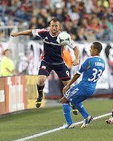 New England Revolution midfielder Chad Barrett (9) works to keep ball in play. Philadelphia Union defender Fabio Alves (33). In a Major League Soccer (MLS) match, the New England Revolution (dark blue) defeated Philadelphia Union (light blue), 5-1, at Gillette Stadium on August 25, 2013.