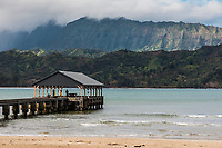 People take in the view from Hanalei Pier at Hanalei Bay and Beach, Kaua'i.