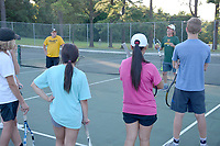 Graham Thomas/Herald-Leader<br /> Volunteer assistant tennis coach Kelly Junkermann goes over a drill with the Siloam Springs tennis team during practice on July 23 at the JBU Tennis Complex.