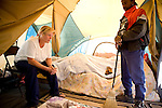RENO, NV - OCTOBER 6:  Mary Jackson, left, and her husband, Howard Jackson, live in a tent city for the homeless in downtown Reno, Nevada October 6, 2008. Mary works odd jobs and Howard, a veteran, works 18 hours per week, but they're unable to make enough money to afford housing. The City of Reno set up the tent city when existing shelters became overcrowded as Nevada struggles with one of the highest unemployment rates in the country. (Photo by Max Whittaker/Getty Images)