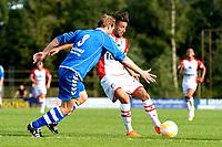EMMEN - Voetbal, VV Emmen - FC Emmen, voorbereiding seizoen 2018-2019, 07-07-2018,  FC Emmen speler Caner Cavlan in duel met Niek Kroeze