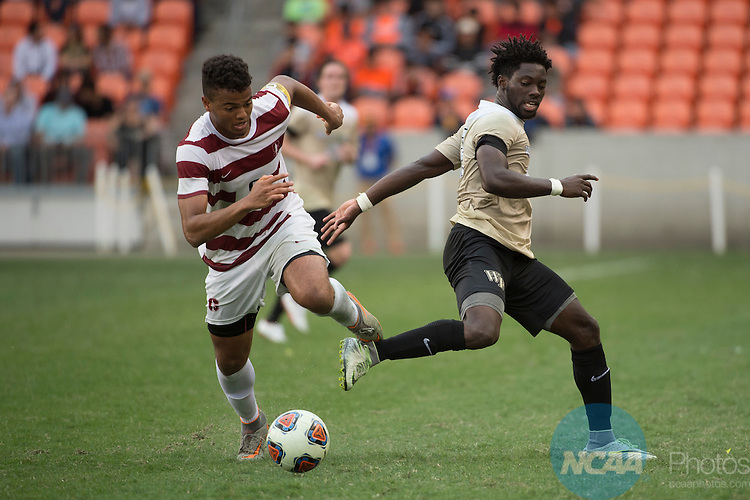 HOUSTON, TX - DECEMBER 11:  Brian Nana-Sinkam (8) of Stanford University dribbles past Ema Twumasi (22) of Wake Forest University during the Division I Men's Soccer Championship held at the BBVA Compass Stadium on December 11, 2016 in Houston, Texas.  Stanford defeated Wake Forest 1-0 in a penalty shootout for the national title. (Photo by Justin Tafoya/NCAA Photos via Getty Images)