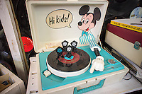A Mickey Mouse themed child's 45rpm record player at The Crate record store in Bushwick in New York on Record Store Day, Saturday, April 19, 2014..  On Record Store Day, now in its eighth year, music lovers are encouraged to support their local non-chain record stores. The Crate was selling all their used records, out of crates hence their name, for one dollar. The store also sells laser cut jewelry made out of recycled vinyl records. Sales of CDs and downloads shrank last year, as shipments of vinyl LPs shot up 32%. Many music consumers are searching for something physical to listen to their music on and prefer the warmer sound of vinyl. (© Richard B. Levine)