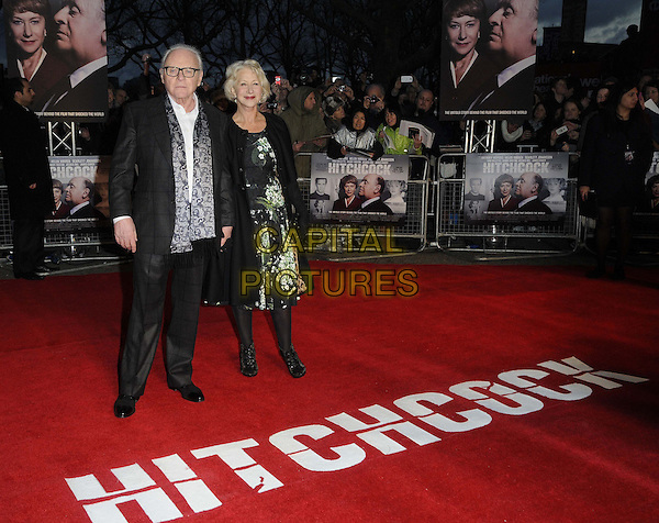 "Sir Anthony Hopkins & Dame Helen Mirren.The UK Premiere of ""Hitchcock"", BFI Southbank, London, England..9th December 2012.full length black coat jacket green white floral print dress gloves grey gray paisley print scarf glasses     .CAP/CAN.©Can Nguyen/Capital Pictures."