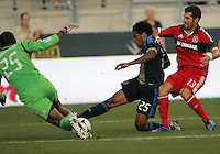 CHESTER, PA - AUGUST 12, 2012:  Sheanon Williams (25) of the Philadelphia Union goes for the ball with  Sean Johnson (25) of the Chicago Fire during an MLS match at PPL Park, in Chester, PA on August 12. Fire won 3-1.