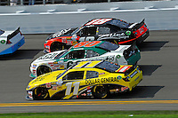 Brian Scott (#11), Trevor Bayne (#60) and Denny Hamlin (#18)