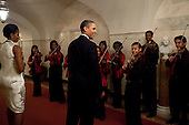 Washington, DC - December 14, 2009 -- United States President Barack Obama and First Lady Michelle Obama greet members of the Strings For Joy ensemble during a holiday party at the White House, Monday, December 14, 2009. .Mandatory Credit: Samantha Appleton - White House via CNP